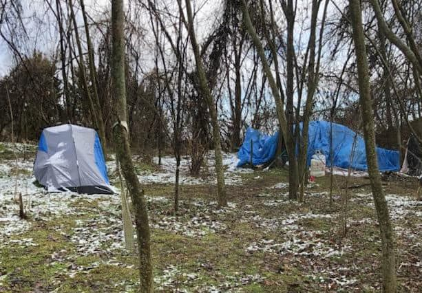 Homeless camping outdoors in tents
