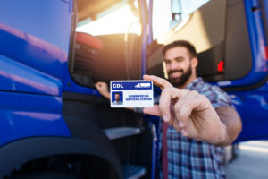 Portrait,Of,Middle,Aged,Bearded,Truck,Driver,Standing,By,The